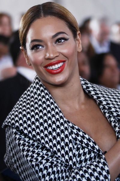 927787_singer-beyonce-applauds-while-sitting-in-the-audience-during-a-ground-breaking-ceremony-for-the-barclays-center-arena-in-the-brooklyn-borough-of-new-york
