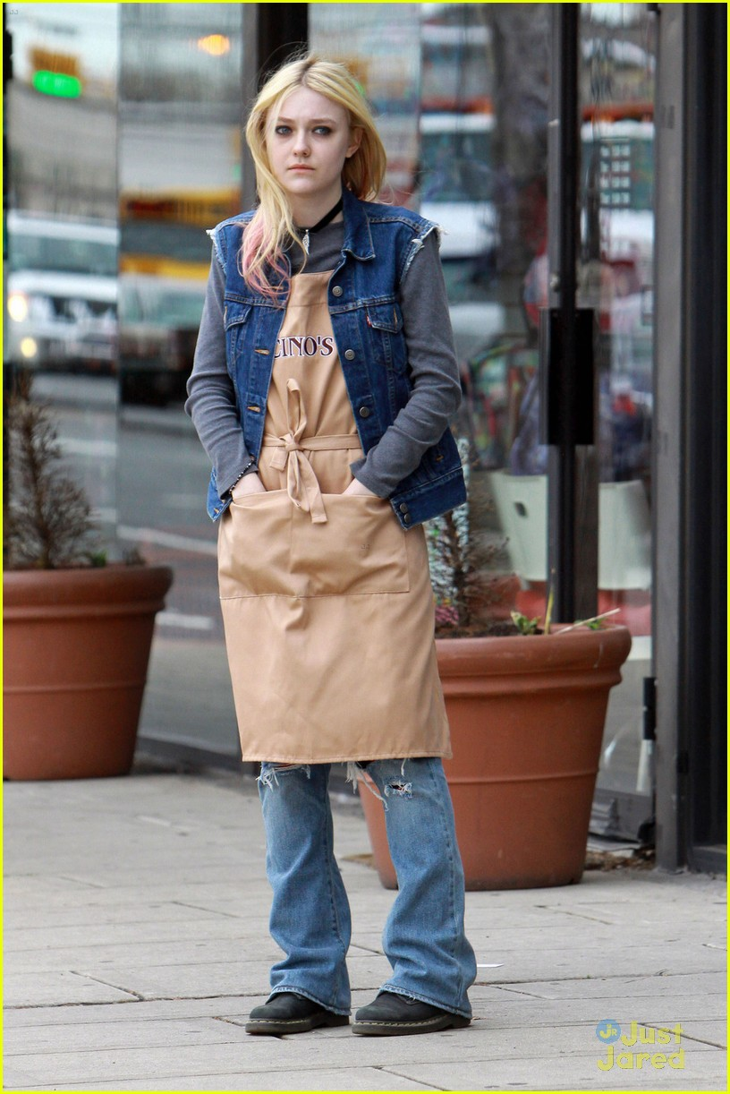 **EXCLUSIVE** Dakota Fanning dresses up as a bagel shop employee to film a scene for 'Every Secret Thing' in New York