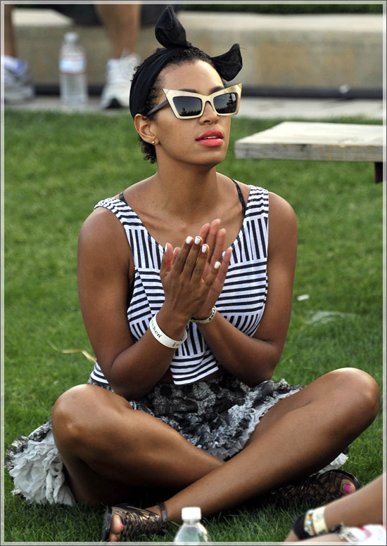 Solange Knowles hangs out a beer and some friends on Day 1 of the Coachella Music Festival in Indio, Ca